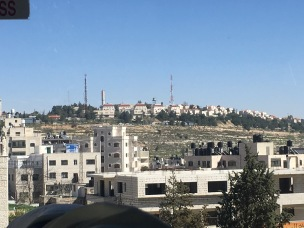 A Jewish settlement on a hill amongst the Palestinian villages of the West Bank.